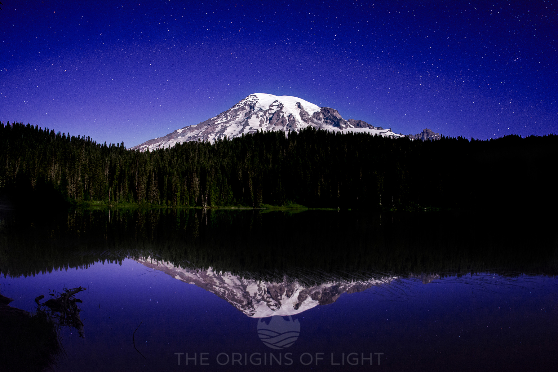 Mt Rainier under a stary sky, reflected in Reflection Lake